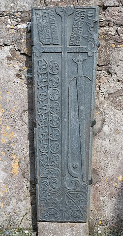 16th century grave slab depicting a hurley stick, sliotar, and sword (located at Clonca Church in Donegal, Ireland) - History of Hockey