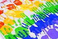 Colorful handprints on a tablecloth.jpg
