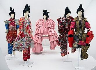 Comme des Garçons - Comme des Garçons garments on display at the Metropolitan Museum of Art