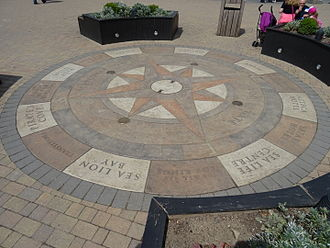 Chessington World of Adventures - Compass in the centre of Adventure Point, with each area in the resort labelled.