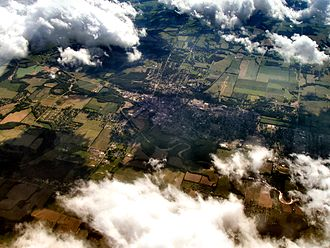 Connersville, Indiana - Connersville from the air, looking west. The Whitewater River is in the foreground, and Roberts Park Grandstand and Race Track are at the bottom right. The Park is home to the Fayette County Free Fair, one of the last free fairs remaining in the state.