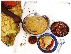 Senegalese cuisine - Couscous Senegalese thièré with chicken and sauce (thièré/chere - same word, spellings vary)