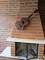 Cuicocha, Ecuador Reserva ecológica Cotacachi-Cayapasm,.interior, guitar on a brick wall. six string.jpg
