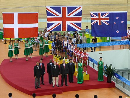 Medal ceremony with the Danish flag, the Union Jack of the United Kingdom, and the New Zealand flag from left to right during the 2008 Summer Olympics CyclingTeamPursuitBeijing2008.jpg