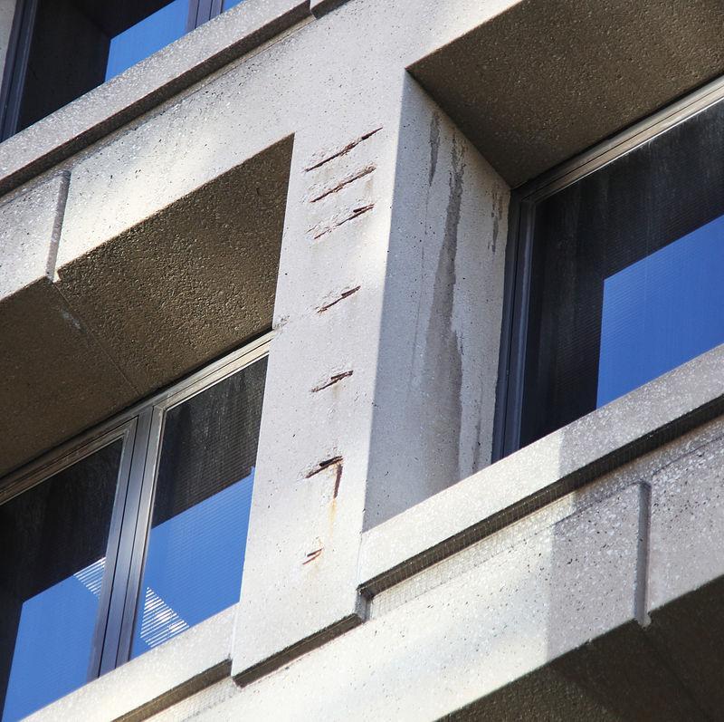 Damaged concrete on east facade - J Edgar Hoover Building - Washington DC - 2012.jpg