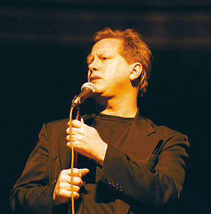 Comedian Darrell Hammond on stage.