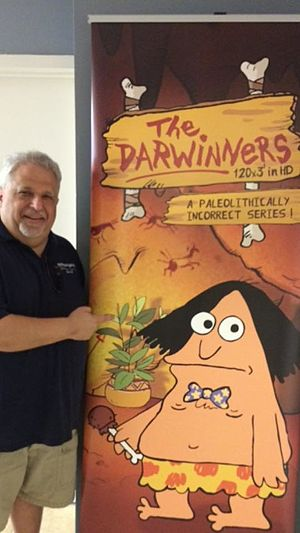 Tom Alexander - Tom Alexander posing with the Darwinners production poster in 2015.