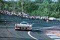Dauer 962 LM - Hans-Joachim Stuck, Thierry Boutsen & Danny Sullivan exits the Esses at the 1994 Le Mans (31970267655).jpg