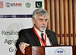 December 16, 2014- Prof. Stephen Davies, Chief of Party, Pakistan Strategy Support Program (PSSP) while delivering his welcome remarks (16032130271).jpg