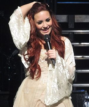 Unbroken (Demi Lovato album) - Lovato performing during her concert tour A Special Night with Demi Lovato on December 2011.