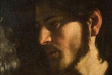 Détail d'un tableau: visage d'un homme barbu tourné vers la gauche, clair-obscur.