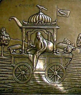 Dhumavati - A silver panel of the door of the Kali temple, Amber Fort depicts Dhumavati on a horseless chariot with a winnowing basket.