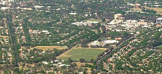 Dickson, Australian Capital Territory - Aerial view from the north east, the shopping centre is on the top right, with Dickson College at the bottom