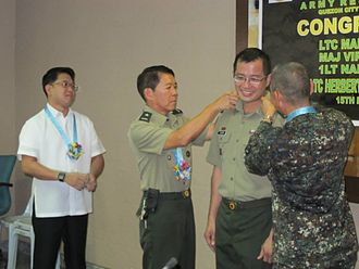 1051st Technical & Administrative Services Unit (Ready Reserve) - 1TASU Commanding Officer - Maj Virgilio Ferrer II during his donning of rank ceremonies at Quezon City Hall.
