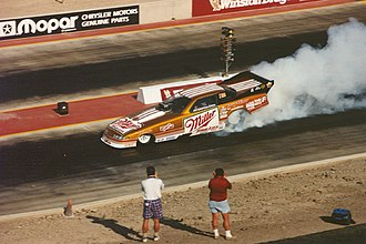 Ed McCulloch - McCulloch's Miller-sponsored Funny Car doing a burnout in testing.