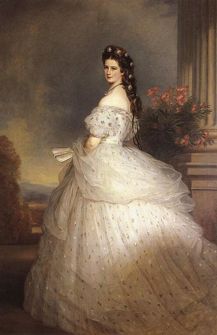 Elisabeth of Bavaria, Empress of Austria (1865), oil on canvas, 255 x 133 cm, Kunsthistorisches Museum, Vienna. This portrait presents the empress in a romantic fashion, enhancing her reputation as one of the great beauties of her time. The empress appears in a sensual pose with naked shoulders and turning her head towards the viewer. She is wearing a white satin and tulle dress dotted with silver foil stars and with diamond stars in her hair. This portrait is one of Empress Elisabeth's most iconic representations and one of Winterhalter's best known works. Empress Elisabeth of Austria with diamond stars on her hair.jpg