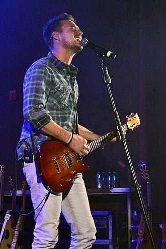 C.R. Alsip Guitars - A musician playing a C.R. Alsip guitar
