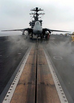 An F-14D Tomcat sits poised for launch on one of four steam-powered catapults aboard the nuclear powered aircraft carrier USS John C. Stennis.
