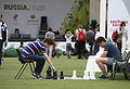 Fans play lawn chess at the Russia House (7741320502).jpg