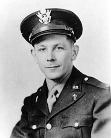 A young looking man in military uniform with crosses on his lapels