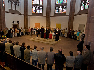 """Paschal mystery - Due to historical context of nominalism promoted by William Ockham, Protestant Eucharist has become more a fraternal meal than a celebration of the paschal mystery. """"Abendmahl"""" during the evangelical service in the church of the Three Kings, Frankfurt am Main."""