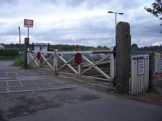 Level crossings in the United Kingdom - A gated crossing at Fiskerton, Nottinghamshire (now MCB-OD), that is manually operated by a signalman. These crossings are slowly becoming rarer as they are being replaced by modern automated crossings.