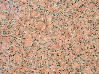 Granite - Granite containing potassium feldspar, plagioclase feldspar, quartz, and biotite and/or amphibole