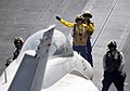Flickr - Official U.S. Navy Imagery - A Sailor signals to a jet to move into position..jpg