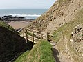 Footbridge takes coastal path across Stanbury Mouth - geograph.org.uk - 412245.jpg