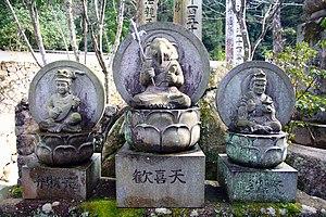 Hinduism in Japan - From left to right, Benzaiten (Hindu equivalent: Sarasvati), Kangiten (Ganesha) and Bishamonten (Kubera) in the Daishō-in temple.