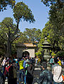 Gate and crowd in Imperial garden at Forbidden City.jpg