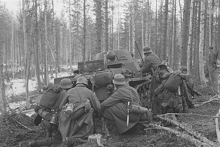 Gebirgsjager of the XVIII Mountain Corps attacking behind Panzer cover in 1942 when Finland and Germany were still at war with the USSR together Gebirgsjager advancing in Arctic Front.jpg