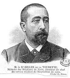 Head and shoulders of a man with a shorter Edwardian beard and closely cropped hair, in a circa-1900 French coat and collar