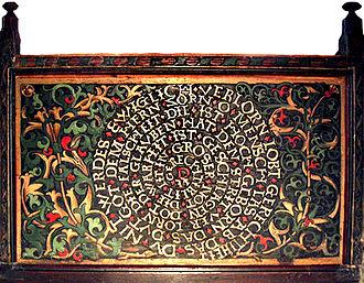 St. Valentin, Kiedrich - Spirale of Justice (Gerechtigkeitsspirale), wood carving on a pew.