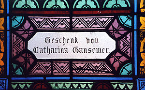 "Roman Catholic Archdiocese of Dubuque - Panel in the church's window donated by Catharina Gansemer (1824-1904), an early parishioner and area pioneer. ""Geschenk von"" means ""gift of."" Photo by Joe Schallan, 2003."