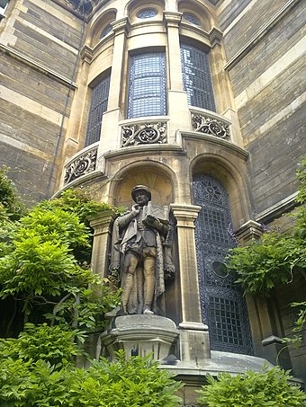 Statue of Stephen Perse, founder of the Perse School in Cambridge, set into the north-east corner of the Waterhouse Building Gonville and Caius exterior framed sculpture.jpg