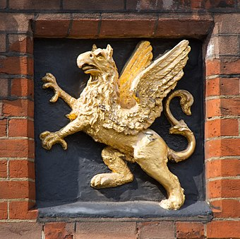 The Gray's Inn badge (a gold griffin on a black field) Gray's Inn Griffin (13917927638).jpg