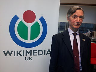 The photo shows Greyham Dawes in the offices of Wikimedia UK