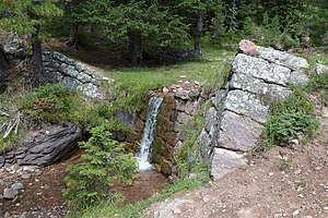 Weir - 19th century weir of porphyry stone on a creek in the Alps. During periods of high river flow this weir would be significantly more substantial.