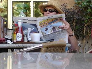 An American woman reads the Gringo Gazette in Cabo San Lucas.