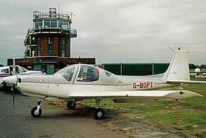 Grob G 115 - Grob G 115A of the Lancashire Aero Club at Manchester (Barton) Aerodrome in 2004 showing the vertical fin of this early version
