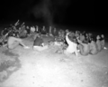 Group of girls in organized club enjoying a campfire circle in South Campground. ; ZION Museum and Archives Image ZION 8725 (b123c16619f64dc9b83be9fe624b5971).tif