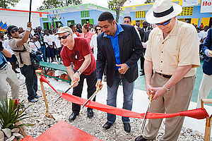 David M. Cote - Cote cuts the ribbon with Richard Walden to open the Ecole Nationale Jacob Martin Henriquez school in Jacmel, Haiti on March 11, 2011.