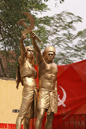 Communist symbolism - A tableau in a communist rally in Kerala, India, showing two farmers forming the hammer and sickle, the most famous communist symbol.