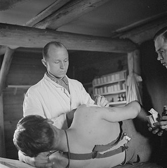 Heikki Savolainen (gymnast) - Savolainen at a field hospital in his wartime duties as a physician with the rank of major