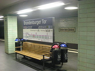 Berlin Brandenburger Tor station - Seats and sign with the station's current name (Brandenburger Tor) on the station's S-Bahn platforms. The station's old name (Unter den Linden) can be seen on the station's wall.