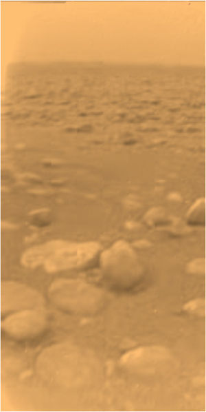Tholin - Surface of Titan as viewed from the Huygens probe. Tholins are suspected to be the source of the reddish color of both the surface and the atmospheric haze.