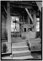 INTERIOR VIEW, DETAIL OF ENCLOSED GRINDING STONE - Mingus Flour Mill, Gatlinburg, Sevier County, TN HAER TENN,78-GAT,2-9.tif