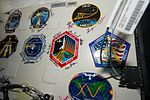 ISS-51 Stickers of past Space Shuttle and ISS missions.jpg