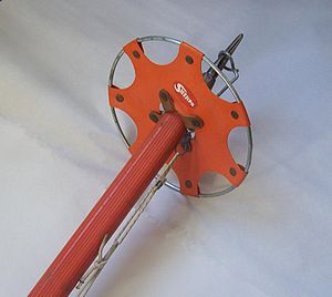 Ice axe - A removable snow basket accessory installed on an ice axe.